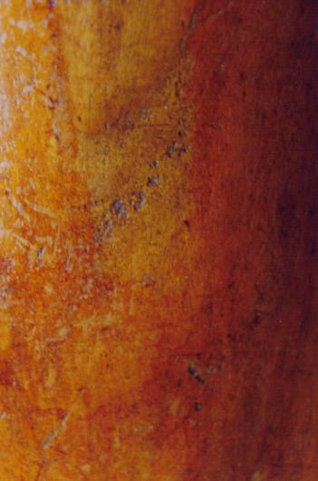 Worn Guarneri cello varnish