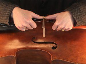 Robin Aitchison straightens cello bridges like this